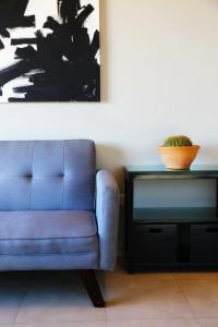 Un lugar para sentarse en Garden Point Luxury Apartments