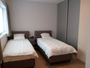 Een bed of bedden in een kamer bij Flats Verrebroek