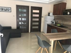 A kitchen or kitchenette at Happy Sun Medencés Apartman