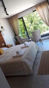 Ein Bett oder Betten in einem Zimmer der Unterkunft Terrazza Suites