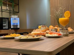 Breakfast options available to guests at Spot Apartments Trindade