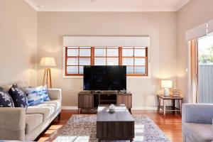 A television and/or entertainment center at Highview House Hunter Valley