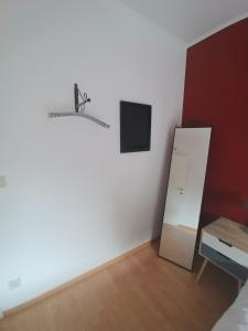 A television and/or entertainment centre at Charming apartment