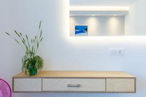 A television and/or entertainment centre at Olia Green Residence