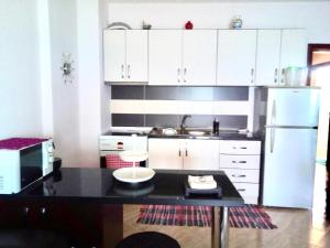 A kitchen or kitchenette at Sea view apartment
