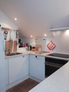 Køkken eller tekøkken på LatterLy Apartments