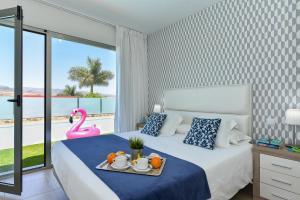 A bed or beds in a room at Top Salobre Villas