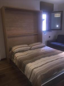 Letto o letti in una camera di Via Privata Tirso 6 Appartamento