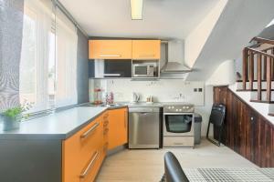 Kuhinja ili čajna kuhinja u objektu Apartment Marlera