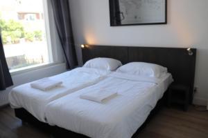 Een bed of bedden in een kamer bij Jordans Residence