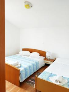 A bed or beds in a room at Sea view Apartments Javor