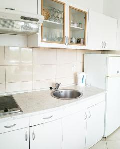 A kitchen or kitchenette at Sea view Apartments Javor