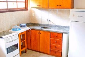A kitchen or kitchenette at Resid. Village do Bosque - Tonziro