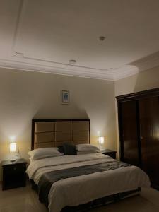 A bed or beds in a room at سماء الطائف للوحدات السكنيه