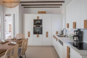 A kitchen or kitchenette at SEACODE VILLA