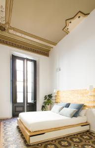 A bed or beds in a room at Apartamento Canela