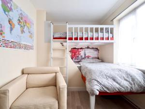 A bunk bed or bunk beds in a room at House147