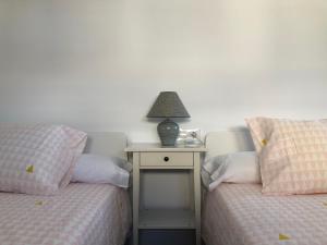"""Cama o camas de una habitación en Apartamento Turístico """"Felicidad"""""""