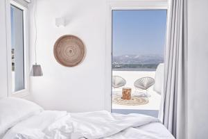A bed or beds in a room at Naxian Utopia | Luxury Villas & Suites
