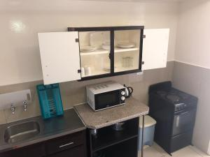 A kitchen or kitchenette at Coastlands Durban Self Catering Holiday Apartments