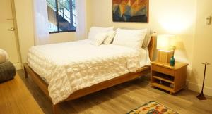 A bed or beds in a room at Times Square of ASTORIA Spacious Modern 4bd 2bath 3rd Floor