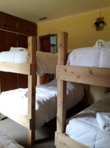 A bunk bed or bunk beds in a room at complejo del bosque