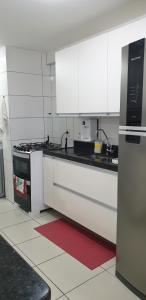 A kitchen or kitchenette at FORTALEZA APTO INTEIRO 6 HOSPEDES