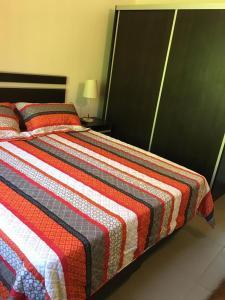 Una cama o camas en una habitación de Apartamento El Maiten