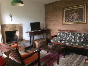 A seating area at Casa de Montanha em S.Pedro