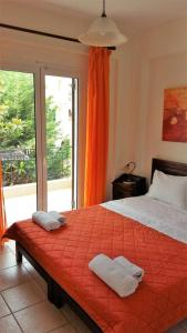 A bed or beds in a room at Philippos Hotel Apartments