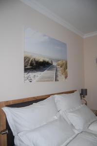 Ein Bett oder Betten in einem Zimmer der Unterkunft Weingut Krikler