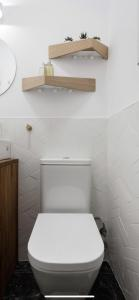 A bathroom at Amazing and new apartment five minutes from gran via