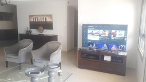 A television and/or entertainment center at City Apartment- Central Location