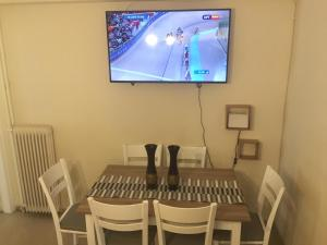A television and/or entertainment centre at Thiseio Big Apartment