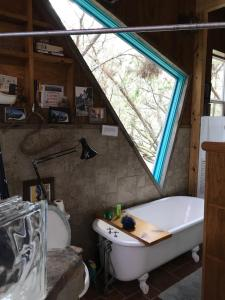 A bathroom at 2 story Barndominium-Treehouse in the woods