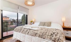 Una cama o camas en una habitación de Tu Apart en Bariloche 1