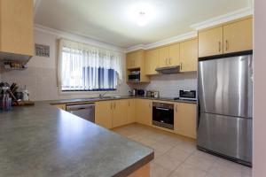 Dapur atau dapur kecil di Albatross Holiday Unit