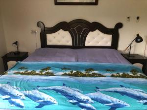 Кровать или кровати в номере My Ozi Perl New Creole Villas
