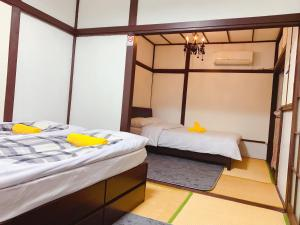 A bed or beds in a room at Zhaohong
