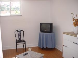 A television and/or entertainment center at António Augusto Apartment