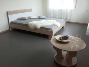A bed or beds in a room at Mežezera stāsts
