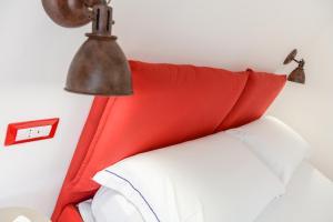 Letto o letti in una camera di Casa Pisacane