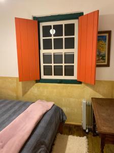 Cama ou camas em um quarto em Chalés da Casa Centenaria