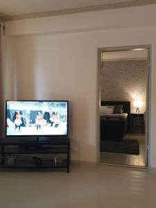 A television and/or entertainment center at Porvoo City Apartments
