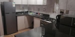 A kitchen or kitchenette at Serengeti Self Catering Apartments