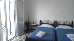 A bed or beds in a room at Sirines