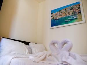 Кровать или кровати в номере Nahalat Yehuda Residence