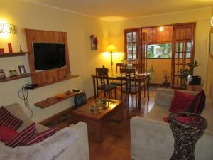 Uma área de estar em Curicó Portugal Apartment