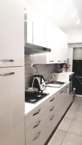 A kitchen or kitchenette at IMMENSO AMORE