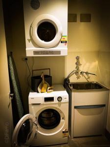 A kitchen or kitchenette at 3BR Designer Penthouse at Rhodes, Shops, Cafes